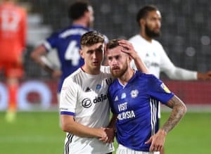 Fulham's Tom Cairney (left) consoles Joe Ralls of Cardiff City.