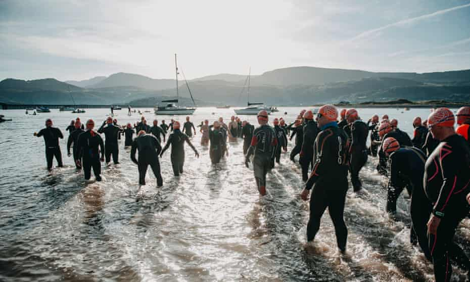 The Outdoor Swimming Society take the plunge in Barmouth, north Wales.