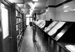 Examining the 'spikes' - short period collections of papers secured by flexible spikes - in the corridor at Cross Street. Despite the modern-day journalist having access to all manner of digital versions of the paper, many still prefer to read the dog-eared, hard-copy papers. (Archive ref. GUA/6/9/1/4/G).