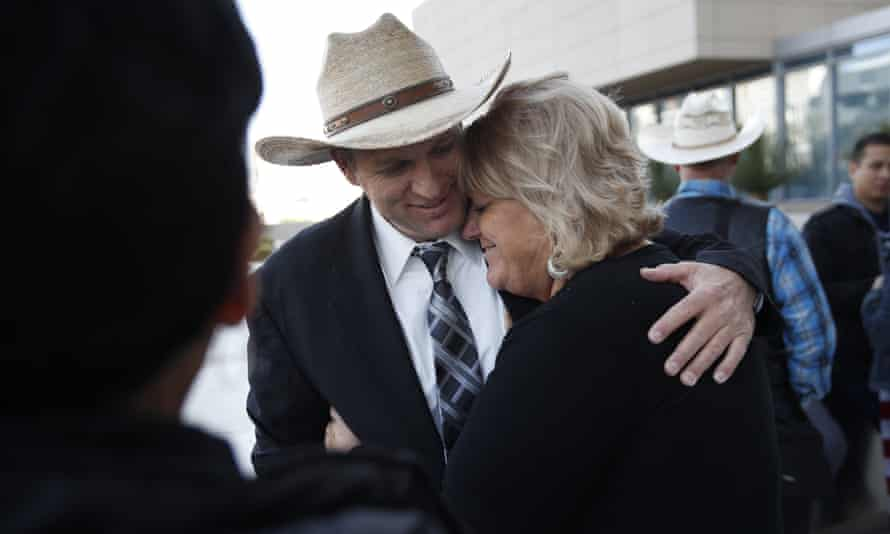 Ammon Bundy hugs is aunt Lillie Spencer outside a federal courthouse in Las Vegas on 20 December. All charges were dismissed Monday.