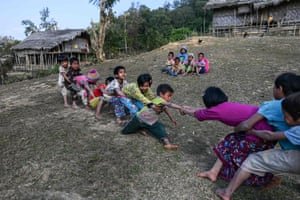 Children play tug-of-war in front of the school in Toe Lawt