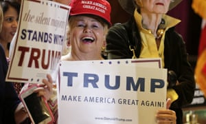 A Trump supporter wears a hat with his campaign slogan: 'Make America Great Again'.