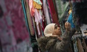 A Muslim woman shopping in Whitechapel, east London