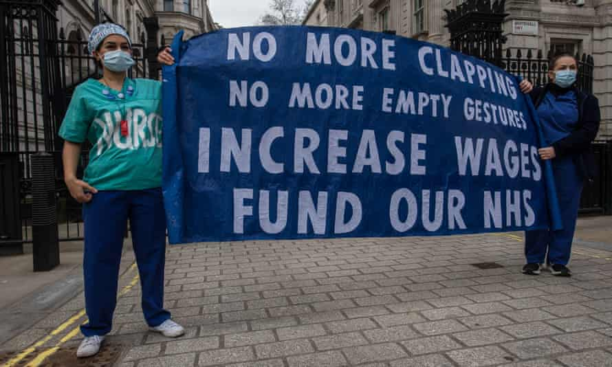 A protest outside Downing Street on 7 March over the government's NHS pay proposal