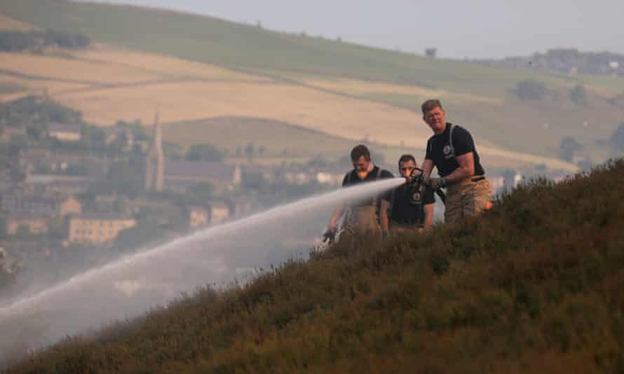Firefighters on Saddleworth Moor in north-west England attempt to stop the spread of fire during Britain's heatwave in June 2018