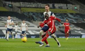 Sadio Mane fires the third goal for the Reds.