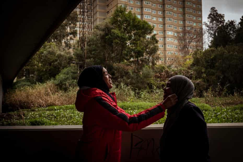 Farhio and her friend Ijabo Hassan enjoy a lighter moment under the bridge adjacent to the flats.