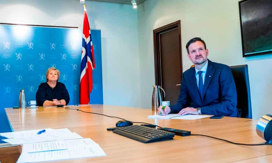 Norway's prime minister, Erna Solberg, and minister for development aid, Dag-Inge Ulstein (right) speak with international leaders online about Covid vaccines, Oslo, September 2020.