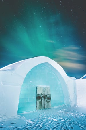 The Icehotel in northern Sweden with the northern lights.