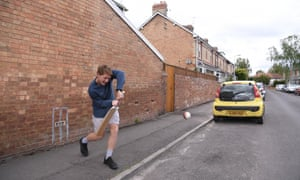 Somerset and England cricketer Dom Bess practices his batting in a street near his home during lockdown.