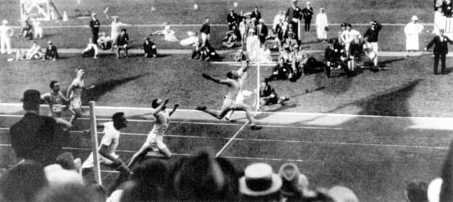 USA's Charley Paddock leaps across the line to win gold from teammate Morris Kirksey (silver) and Great Britain's Harry Edward (closest to camera) judged to have pipped Jackson Scholz for the bronze in the final of 1920 Olympic 100m in Antwerp