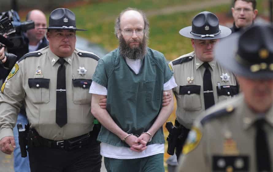 Knight is escorted into Kennebec County Superior Court to enter pleas for multiple burglaries and thefts.