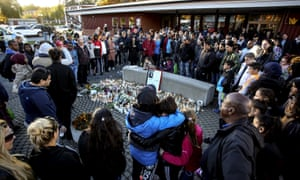 Mourners outside Kronan school, scene of Thursday's attack that left a teaching assistant and a boy dead. The school is in a suburb where most people have immigrant backgrounds.