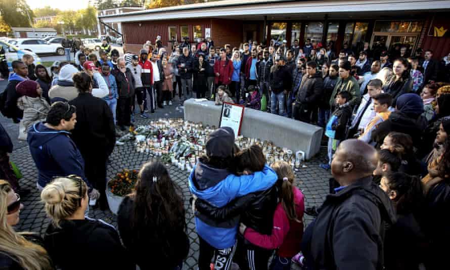 Mourners outside Kronan school in Trollhättan