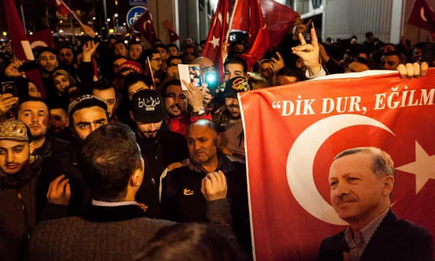 Turkish people gather to protest outside the Turkish consulate general's residence in Rotterdam