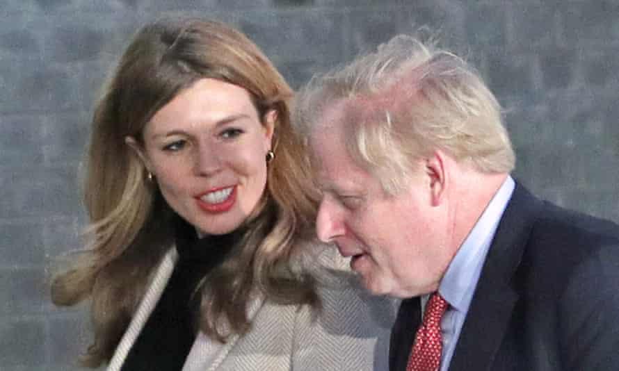Carrie Symonds looks at Boris Johnson