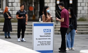 People queue up at a Covid vaccination centre in London.