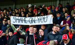 Gloucester fans waved money and displayed a banner when playing Saracens last weekend.