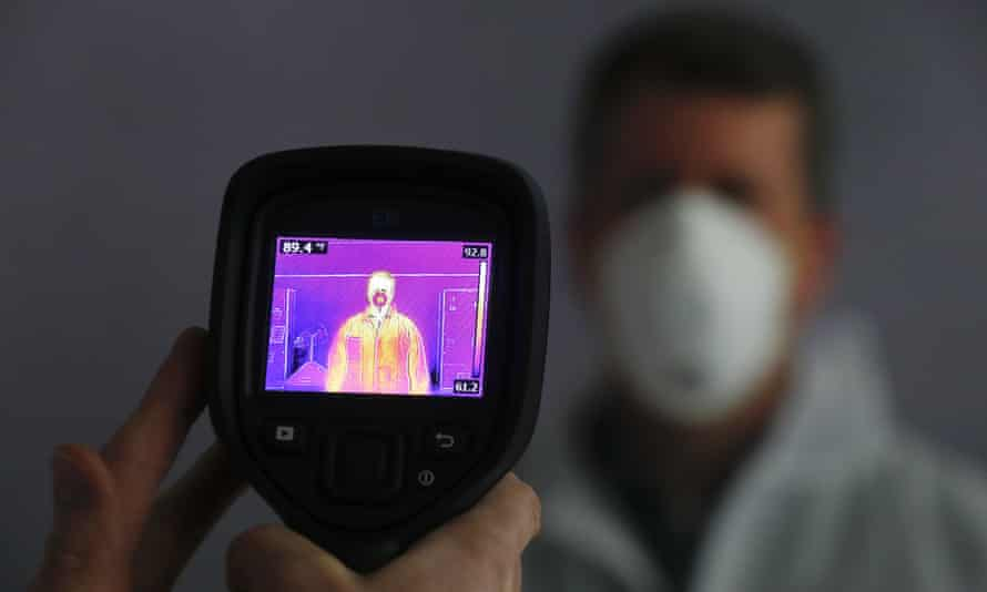An infrared camera scans a person for elevated body temperature