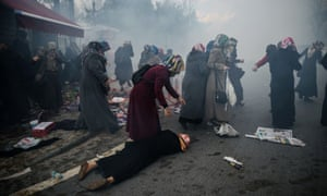 Women protesting against the seizure of the offices of the Zaman newspaper in Istanbul being dispersed by teargas
