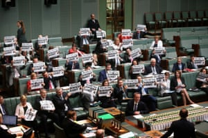 """Abbott comes under fire from the opposition who taunt him with the headline from the Herald Sun newspaper """"bowser bandit"""" during question time on October 29, 2014."""