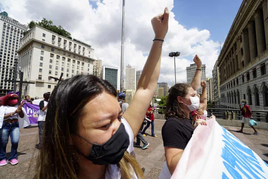 Women take part in a protest against Jair Bolsonaro, demanding coronavirus vaccines and emergency aid, on International Women's Day in Sao Paulo, Brazil on 8 March.