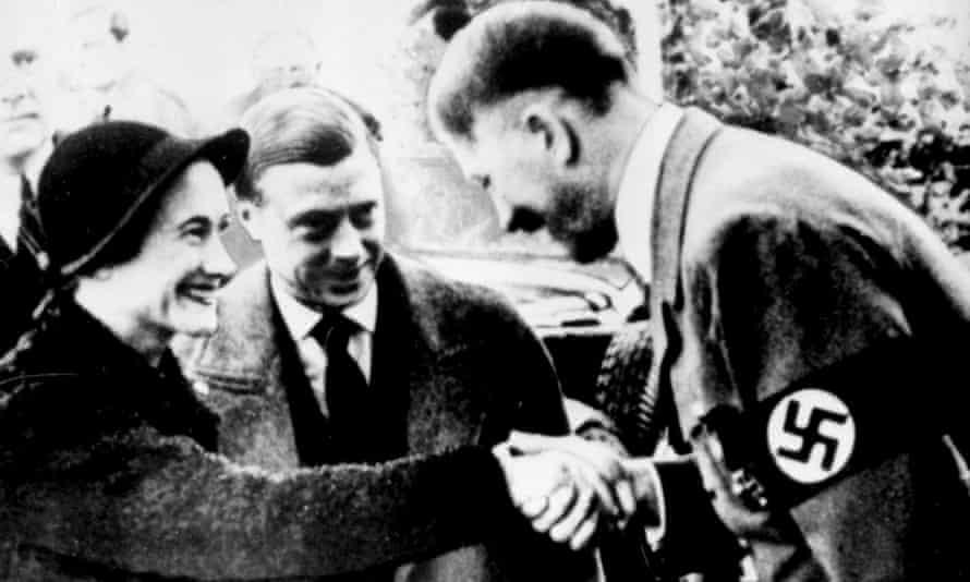 The Duke and Duchess of Windsor greet Adolf Hitler.