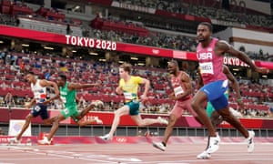 Zharnel Hughes of Great Britain (left) crosses the line to win the semi-final next to him is Nigeria's Enoch Adegoke who finishes second.