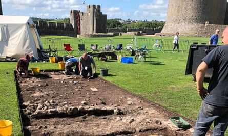 Archaeologists uncovering walls of a late medieval house in the grounds of Pembroke Castle.