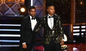 Aziz Ansari and Lena Waithe accepting their award at the 69th Emmys