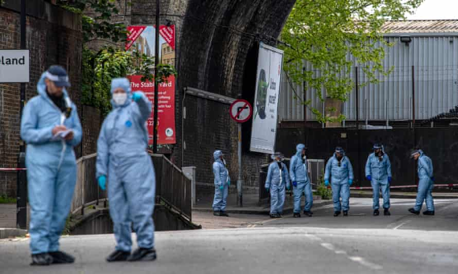 Police forensic officers on Consort Road.