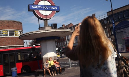 People pose for pictures outside Gareth Southgate station