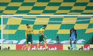 Norwich City's goalkeeper Tim Krul (right) reacts after Ben Godfrey (left) scored an own goal.