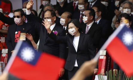 Taiwan's President Tsai Ing-wen cheers with National Day celebrations, saying she has hopes for less tensions with China and in the region if Beijing will listen to Taipei's concerns, alter its approach and restart dialogue with the self-ruled island democracy.
