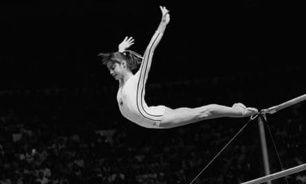Nadia Comăneci, of Romania, dismounts during a perfect 10 performance.