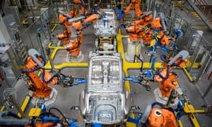 Robotic arms rivet car panels together in Birmingham