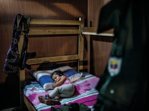 Sara Manuela, age 2, sleeps in a simple house of a FARC-commander surrounded by a FARC-uniform and a gun. Her mother and father are both holding high positions inside the movement and have only decided to have a child because they believe in the peace process and the prospect of returning to the civilian life