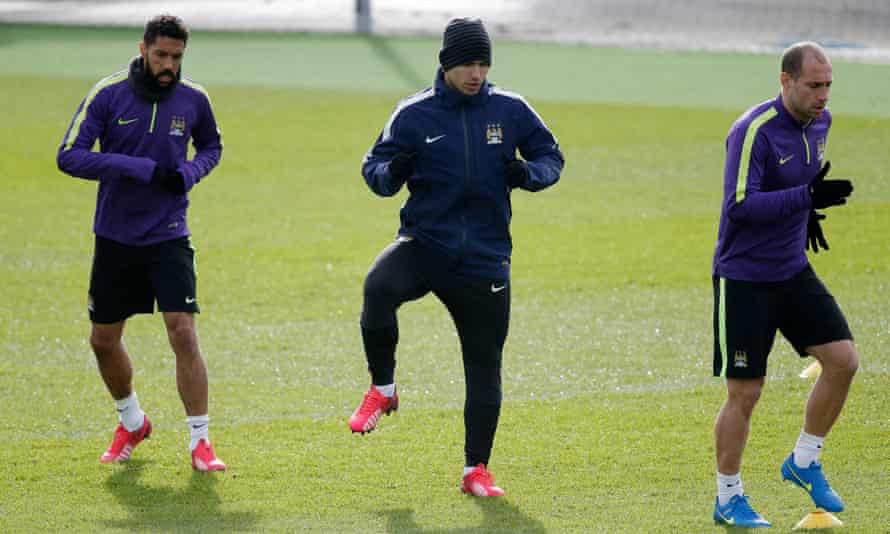 Gaël Clichy (left) trains with Sergio Aguero and Pablo Zabaleta in February 2015.