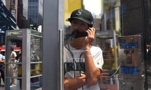 A man in a telephone booth in NYC