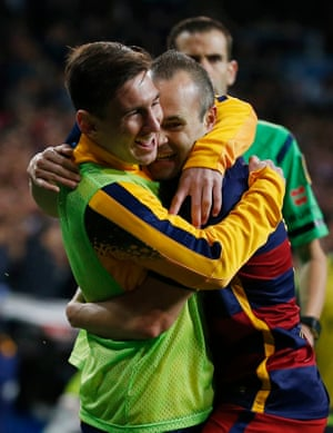 Then gets a congratulatory hug from Lionel Messi.