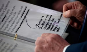 Notes are seen as US President Donald Trump speaks during the daily briefing on the novel coronavirus, COVID-19, at the White House on April 4, 2020.