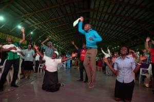Congregation pray during a service.