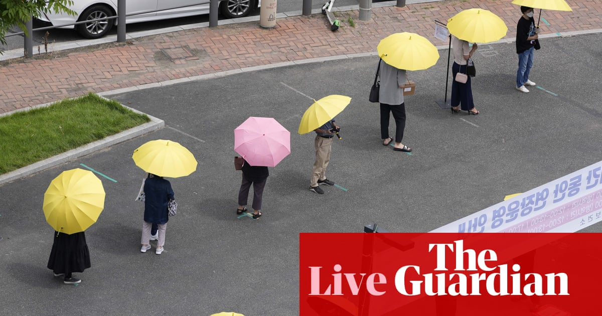 Coronavirus live news: South Korea tightens curbs again amid record cases; interest in Tokyo Olympics 'muted'