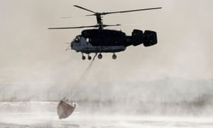 Catalonia, Spain A helicopter collects water before dropping it over a forest fire raging near La Torre de l'Espanyol