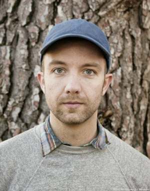 Jon Klassen, wearing hat.