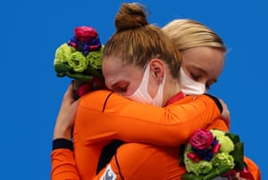 Gold medalist Chantalle Zijderveld (left) celebrates on the podium with silver medalist and compatriot Lisa Kruger after a Dutch one-two in the SB9 100m breaststroke final.