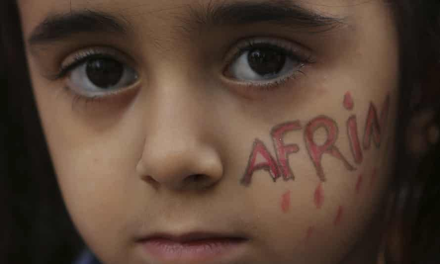 A Kurdish girl with Afrin painted on her face.