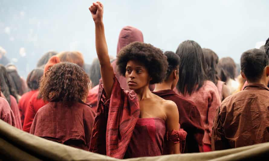 A model delivers a black power salute during the show.
