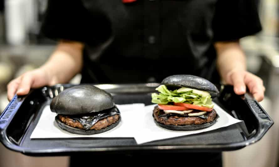 Burger King's black burgers have black buns and cheese smoked with bamboo charcoal and black sauce made of squid ink.