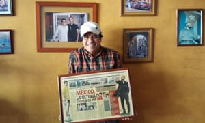 Restaurant owner José Luis Bracamontes, holding a newspaper spread about Pep Guardiola's stay in Mexico with Dorados de Sinaloa in 2006.